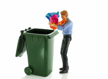 Man throw old paper in container Royalty Free Stock Photo