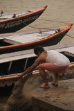 Man throwing ashes to the Ganges Stock Photo