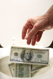 Man throwing away money Stock Photography
