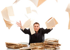 Man throwing away paperwork. Angry business man throwing away lots of paperwork Royalty Free Stock Photo