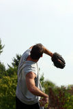 Man Throwing Ball Stock Images