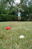 Man Throwing Balls Stock Photography