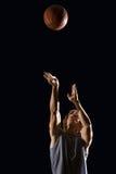Man throwing basketball Royalty Free Stock Image