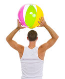 Man throwing beach ball. Rear view Royalty Free Stock Image