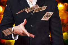 Man throwing cards. Poker game Stock Photography
