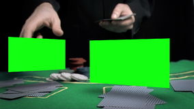 Man throwing cards on the table Stock Image