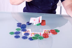 Man Throwing Cards on the Table in Texas Hold'em Stock Photo