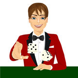 Man throwing the dice gambling playing craps. Portrait of handsome man throwing the dice gambling playing craps on green table Stock Photos