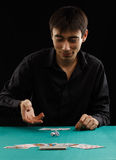 Man throwing dice on a gambling table Royalty Free Stock Photo