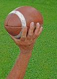 Man throwing football Stock Images