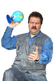 Man throwing globe Stock Images