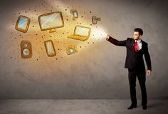 Man throwing hand drawn electronical devices Royalty Free Stock Photography