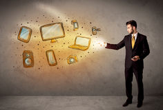 Man throwing hand drawn electronical devices. Concept Stock Image