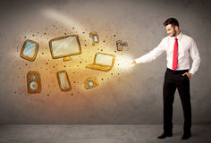 Man throwing hand drawn electronical devices Royalty Free Stock Images