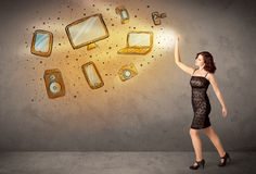 Man throwing hand drawn electronical devices Royalty Free Stock Photo