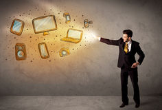 Man throwing hand drawn electronical devices Stock Photos