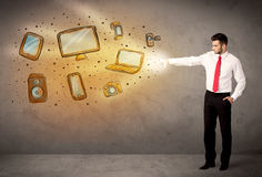 Man throwing hand drawn electronical devices Stock Image