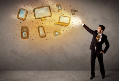 Man throwing hand drawn electronical devices. Concept Royalty Free Stock Photo