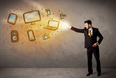 Man throwing hand drawn electronical devices. Concept Stock Photo