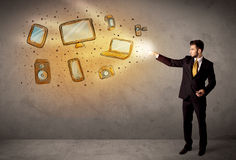 Man throwing hand drawn electronical devices. Concept Stock Photos
