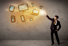 Man throwing hand drawn electronical devices. Concept Stock Photography