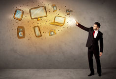 Man throwing hand drawn electronical devices. Concept Royalty Free Stock Photography