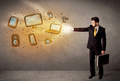 Man throwing hand drawn electronical devices. Concept Royalty Free Stock Images