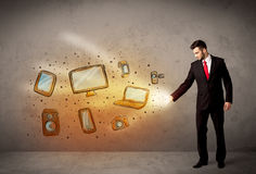 Man throwing hand drawn electronical devices. Concept Royalty Free Stock Photos
