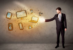 Man throwing hand drawn electronical devices. Concept Stock Images
