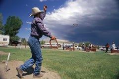 Man throwing horseshoe Stock Images