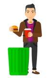 Man throwing junk food Stock Photo
