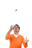 Man throwing light bulb in the air Stock Photography