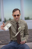 Man throwing the money Stock Photo