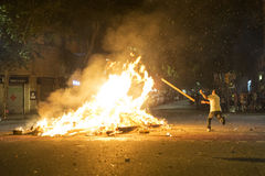 Man throwing objects at a bonfire, Barcelona Stock Photo