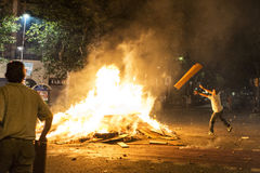 Man throwing objects at a bonfire, Barcelona Stock Images