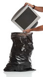 Man throwing a pc monitor in the garbage Stock Photos