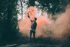 Man Throwing Peach-colored Powder Royalty Free Stock Photography