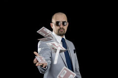 Man throwing playing cards up in the air isolated Stock Photo