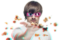 Man throwing popcorn at the viewer. Young man in stereo glasses throwing popcorn at the viewer 3d movie concept stock images