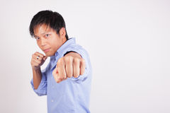 Man throwing a punch Stock Photos