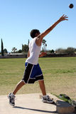 Man throwing shot put. Athlete throwing a shot put ball Royalty Free Stock Image