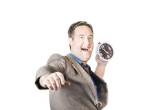 Man throwing time out window with chucking clock Royalty Free Stock Photography