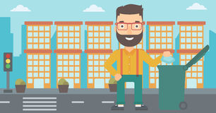 Man throwing trash. A hipster man with the beard throwing a trash into a green bin on a city background vector flat design illustration. Horizontal layout stock illustration