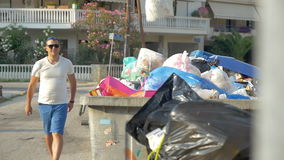 Man Throwing Trash Pack to Container stock video