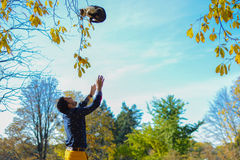 Man throwing-up cat in the park Royalty Free Stock Image