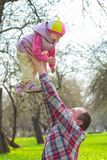Man throwing up laughing toddler girl Royalty Free Stock Images