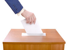 Man throws ballots into a ballot box. Against a white background. Election Day Royalty Free Stock Photography