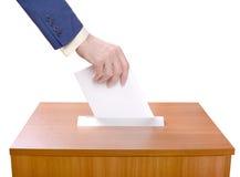 Man throws ballots into a ballot box Royalty Free Stock Photography