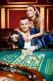 Man throws the chip on the casino table Stock Image