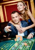 Man throws the chip on the roulette table Stock Image